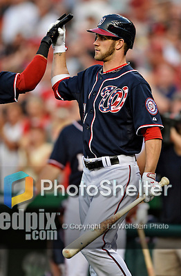 "16 May 2012: Washington Nationals outfielder Bryce Harper gets a ""high-five"" during a game against the Pittsburgh Pirates at Nationals Park in Washington, DC. The Nationals defeated the Pirates 7-4 in the first game of their 2-game series. Mandatory Credit: Ed Wolfstein Photo"
