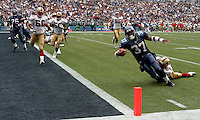 Seahawks runningback Shaun Alexander(37) stretches for a touchdown in the first half of the game. Alexander scored three touchdowns in the game at Qwest Field in Seattle on September 26, 2004.