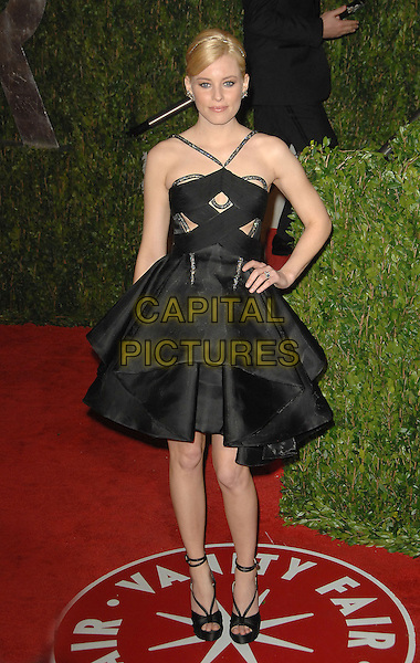 ELIZABETH BANKS.The 2010 Vanity Fair Oscar Party held at The Sunset Tower Hotel in West Hollywood, California, USA..March 7th, 2010.oscars full length black pleats dress hand on hip.CAP/RKE/DVS.©DVS/RockinExposures/Capital Pictures.