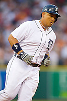 Miguel Cabrera (24) of the Detroit Tigers rounds third base after hitting a 2-run home run against the Los Angeles Angels at Comerica Park on June 25, 2013 in Detroit, Michigan.  The Angels defeated the Tigers 14-8.  (Brian Westerholt/Four Seam Images)