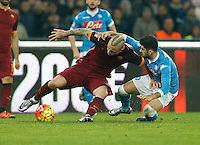 AS Roma's Radja Nainggolan fight for the ball with Napoli's Elseid Hysaj during the  italian serie a soccer match,between SSC Napoli and AS Roma       at  the San  Paolo   stadium in Naples  Italy ,December 13, 2015