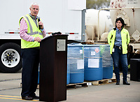 Melissa Hanesworth (right), of Pernod Ricard USA, listens to Congressman Steve Womack Friday, March 20, 2020, as he speaks about the newly produced hand sanitizer at the facility in Fort Smith. As of Friday, the company is using its Fort Smith facility to produce and donate hand sanitizer to address supply shortages and help meet national needs as a response to the covid-19 virus. Check out nwaonline.com/2003221aily/ and nwadg.com/photos for a photo gallery.<br /> (NWA Democrat-Gazette/David Gottschalk)