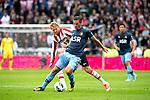 Nederland, Den Haag, 23 september  2012.Seizoen 2012/2013.Eredivisie.PSV-Feyenoord.Ola Toivonen van PSV in duel om de bal met Wesley Verhoek van Feyenoord
