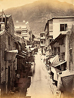 BNPS.co.uk (01202 558833)<br /> Pic: DominicWinterAuction/BNPS<br /> <br /> Cochrane Street in Hong Kong.<br /> <br /> Revealed - A fascinating photo album from the very early days of British Hong Kong...long before the skyscrapers covered it over.<br /> <br /> The 150 year old photos of Hong Kong taken by one of the first British photographers to venture to the Far East have emerged for sale for £15,000.<br /> <br /> John Thomson, who was also a geographer, left Edinburgh for Singapore in 1862 and spent the following decade travelling the region.<br /> <br /> He explored a decidely low-rise Hong Kong from 1868 to 1870, taking numerous pictures of the rapidly expanding settlement and its industrious inhabitants.<br /> <br /> They capture the area, which is currently engulfed in unrest and protest, at a far more tranquil time.<br /> <br /> The photos are being sold with auction house Dominic Winter, of Cirencester, Gloucs.