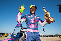 Oct 16, 2016; Ennis, TX, USA; NHRA top fuel driver Antron Brown celebrates after winning the Fall Nationals at Texas Motorplex. Mandatory Credit: Mark J. Rebilas-USA TODAY Sports