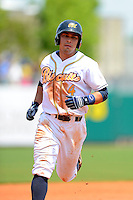 Montgomery Biscuits third baseman Riccio Torrez #4 runs the bases after hitting a home run during a game against the Mobile BayBears on April 16, 2013 at Riverwalk Stadium in Montgomery, Alabama.  Montgomery defeated Mobile 9-3.  (Mike Janes/Four Seam Images)