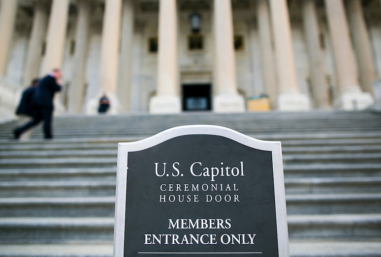 UNITED STATES - JULY 29: Congressmen head up the House steps at the Capitol following for the final votes before the August recess on Wednesday, July 29, 2015. The House of Representatives will not meet again until September 8, 2015. (Photo By Al Drago/CQ Roll Call)