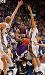 SIOUX FALLS, SD - MARCH 9:  Jabari Sandifer #1 from Western Illinois takes the ball to the basket between Connor Devine #30 and Brayden Carlson #12 from South Dakota State University in the second half of their quarterfinal game at the 2014 Summit League Tournament Sunday evening in Sioux Falls, SD. (Photo by Dave Eggen/Inertia)