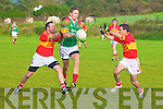 Padraig King for St Michaels/Foilmore managed to get this ball away even with the strong challenges from Valentia's John Daly & Raymond Lyne. St Michaels/Foilmore 1-16 Valentia 1-2.