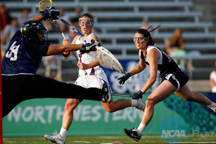 25 May 2008:  Goalie Sarah Waxman (99) of the University of Pennsylvania makes a save on a shot by Hannah Nielsen (7) of Northwestern University during the Division I Women?s Lacrosse Championship held at Johnny Unitas Stadium on the Towson University campus in Towson, MD.  Northwestern defeated Penn 10-6 for its fourth consecutive national title.   Alex Cena/NCAA Photos