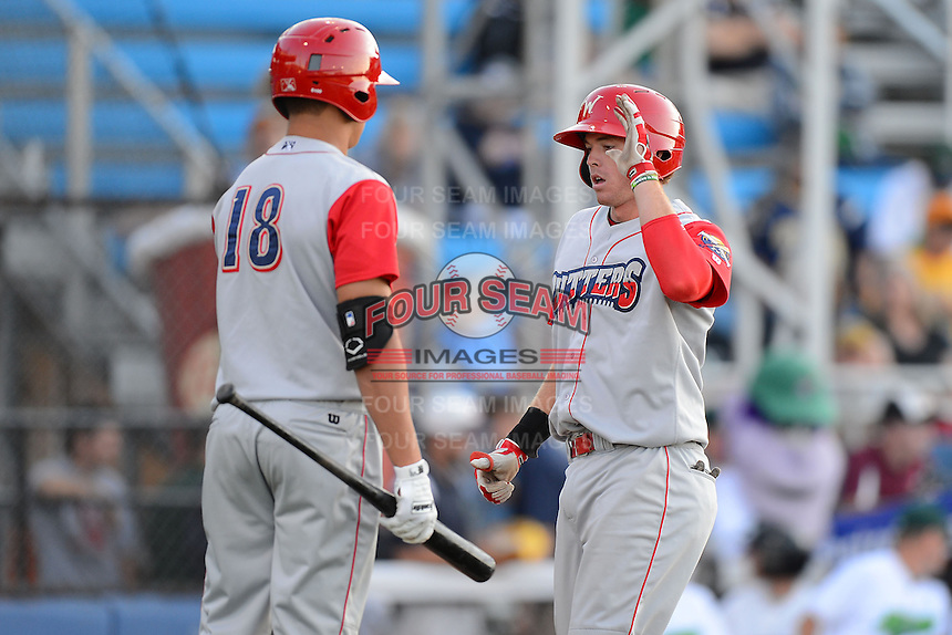 Williamsport Crosscutters third baseman Zach Green #12 greeted by Dylan Cozens #18 after hitting a home run during a game against the Jamestown Jammers on June 20, 2013 at Russell Diethrick Park in Jamestown, New York.  Jamestown defeated Williamsport 12-6.  (Mike Janes/Four Seam Images)
