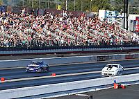 Feb 8, 2015; Pomona, CA, USA; NHRA pro stock driver Shane Gray (right) races alongside Jason Line during the Winternationals at Auto Club Raceway at Pomona. Mandatory Credit: Mark J. Rebilas-