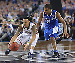 UConn guard Shabazz Napier (13) and UK guard Aaron Harrison (2) scramble for the ball during the NCAA Championship vs. UConn at the AT&T Stadium in Arlington, Tx., on Monday, April 7, 2014. Photo by Emily Wuetcher | Staff
