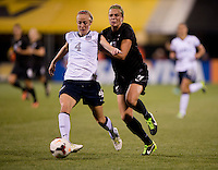 Becky Sauerbrunn (4) of the USWNT pushes the ball away from Hannah Wilkinson (17) of New Zealand during an international friendly at Crew Stadium in Columbus, OH. The USWNT tied New Zealand, 1-1.