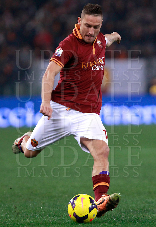 Calcio, quarti di finale di Coppa Italia: Roma vs Juventus. Roma, stadio Olimpico, 21 gennaio 2014.<br /> AS Roma forward Francesco Totti in action during the Italian Cup round of eight final football match between AS Roma and Juventus, at Rome's Olympic stadium, 21 January 2014.<br /> UPDATE IMAGES PRESS/Isabella Bonotto