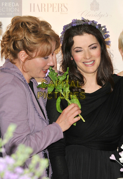 EMMA THOMPSON & NIGELLA LAWSON.10th Anniversary Party of the Lavender Trust at Breast Cancer Care, .Claridges Hotel, London, England, UK.1st May 2008..half length smelling flowers leaf stalk holding lavender in hair on head hairband headband .CAP/PL.©Phil Loftus/Capital Pictures