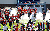 The Virginia Cavaliers run onto the field at the start of the football game against Ball State Saturday Oct. 5, 2013 at Scott Stadium in Charlottesville, VA. Ball State defeated Virginia 48-27. Photo/The Daily Progress/Andrew Shurtleff