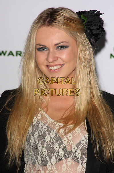 "ZOE SALMON .""Call Of Duty - Modern Warfare 2"" Video Game Launch at the Vue Cinema, Leicester Square, London, England, November 9th 2009..portrait headshot flower in hair smiling see through bra lace sheer top black cream underwear .CAP/ROS.©Steve Ross/Capital Pictures."