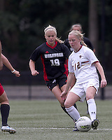 Boston College midfielder Julia Bouchelle (12) passes the ball as NC State midfielder Reilly Brown (19) closes. Boston College defeated North Carolina State,1-0, on Newton Campus Field, on October 23, 2011.
