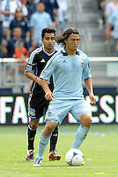 Kansas City midfielder Roger Espinoza (15) in action... Sporting Kansas City defeated San Jose Earthquakes 2-1 at LIVESTRONG Sporting Park, Kansas City, Kansas.
