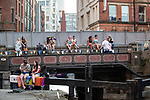 © Joel Goodman - 07973 332324 - all rights reserved . 25/08/2019. Manchester, UK. People sit across the bridge on Canal Street . Revellers in Manchester's Gay Village during the city's annual Gay Pride festival , which celebrates LGBTQ+ life and is the largest of its type in Europe . Photo credit : Joel Goodman