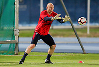 GEORGETOWN, GRAND CAYMAN, CAYMAN ISLANDS - NOVEMBER 19: Brad Guzan #1 of the United States warming up during a game between Cuba and USMNT at Truman Bodden Sports Complex on November 19, 2019 in Georgetown, Grand Cayman.