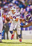 19 October 2014: Buffalo Bills quarterback Kyle Orton scrambles in the backfield under pressure during the third quarter against the Minnesota Vikings at Ralph Wilson Stadium in Orchard Park, NY. The Bills defeated the Vikings 17-16 in a dramatic, last minute, comeback touchdown drive. Mandatory Credit: Ed Wolfstein Photo *** RAW (NEF) Image File Available ***