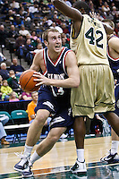 February 03, 2011:   Belmont Bruins guard/forward Jon House (13) drives around Jacksonville Dolphins center Glenn Powell (42) during  Atlantic Sun Conference action between the Jacksonville Dolphins and the Belmont Bruins at Veterans Memorial Arena in Jacksonville, Florida.  Belmont defeated Jacksonville 76-70.