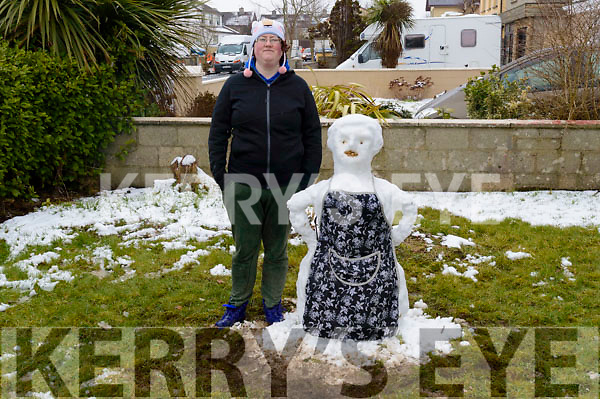 Tralee IT Student, Helen Edgar pictured beside her Mrs Brown snow(wo)man creation in Tralee on Friday
