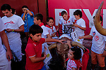 Children touch a model bull used to train bullfighters after the bull run of the San Sebastian de los Reyes Festival near Madrid, on August 26, 2014. © Pedro ARMESTRE