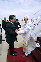 "King Abdullah II of Jordan, left, receives Pope Benedict XVI on his arrival in Amman, Jordan, Friday, May, 8, 2009. Pope Benedict XVI begins a week long tour in the Middle East on Friday that includes Jordan and Israel, and the Palestinian territories. In his first visit as pope to an Arab country, Benedict will meet with Muslim religious leaders at Amman's largest mosque. A self-described ""pilgrim of peace"" seeking to strengthen frayed ties with Muslims and Jews and give support to his beleaguered Christian flock in the region"