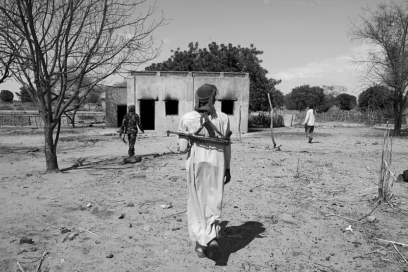 Western Sudan, June 16, 2004.A group of 'SLA' rebels in Terbeba, a Sudanese 'ghost-town' in western Darfur, looted by Janjavid militia