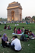Indian families relax in the lawns of India Gate in New Delhi, India  Photograph: Sanjit Das/Panos