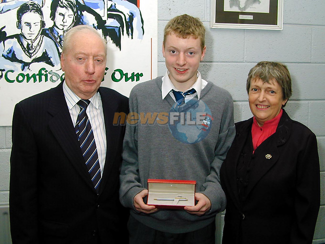 Ambrose Carr who recieved the Peader McCann prize for best Junior Cert with his parents Ambrose Sr. and Brid..Picture Paul Mohan Newsfile