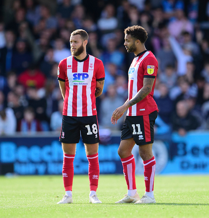 Lincoln City's Jorge Grant, left, and Bruno Andrade<br /> <br /> Photographer Andrew Vaughan/CameraSport<br /> <br /> The EFL Sky Bet League One - Wycombe Wanderers v Lincoln City - Saturday 7th September 2019 - Adams Park - Wycombe<br /> <br /> World Copyright © 2019 CameraSport. All rights reserved. 43 Linden Ave. Countesthorpe. Leicester. England. LE8 5PG - Tel: +44 (0) 116 277 4147 - admin@camerasport.com - www.camerasport.com