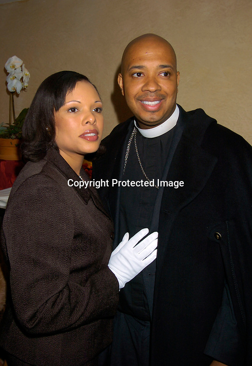 Reverand Run and wife Justine ..at The Phoenix House Benefit honoring Hip-Hop giant Russell Simmons on March 31, 2004 at the W Hotel in..New York City. Photo by Robin Platzer, Twin Images