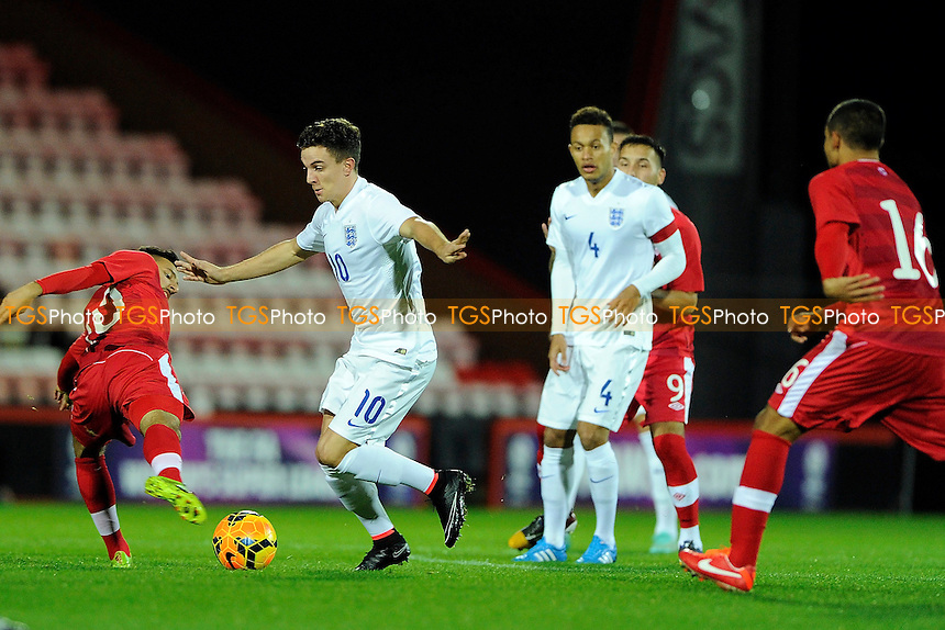 Josh Harrop of England evades the tackle of Dylan Carreiro of Canada - England Under-20 vs Canada Under-20 - International Football at AFC Bournemouth, Goldsands Stadium, Kings Park, Boscombe, Bournemouth, Dorset - 12/11/14 - MANDATORY CREDIT: Denis Murphy/TGSPHOTO - Self billing applies where appropriate - contact@tgsphoto.co.uk - NO UNPAID USE