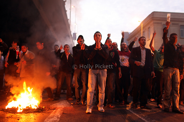 Protesters chant next to burning tires in downtown Cairo, Egypt, Jan. 26, 2011. Violent clashes between demonstrators and police continued into a second day, as protesters attempted to build momentum in a movement inspired by the recent Tunisian uprising.