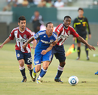 KC Wizard midfielder Ryan Smith (11) splits the Chivas USA defense during the first half of the game between Chivas USA and the Kansas City Wizards at the Home Depot Center in Carson, CA, on September 19, 2010. Final score Chivas USA 0, Kansas City Wizards 2.
