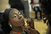 Makeup time before a multi-cultural charity Fashion Show put on by students reflecting the wide cultural diversity of the student base at Kingston College.