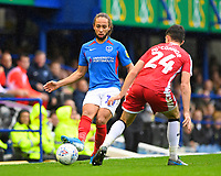 Marcus Harness of Portsmouth plays a pass past Thomas O'Connor of Gillingham during Portsmouth vs Gillingham, Sky Bet EFL League 1 Football at Fratton Park on 12th October 2019