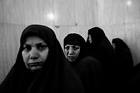 Baghdad, Iraq, March 13, 2003.On the morning of Ashura (commemoration of the death of Imam Hussein), Shia'i women praying inside Al Khaddamein mosq, one of the most important Shia'i shrines in Iraq.