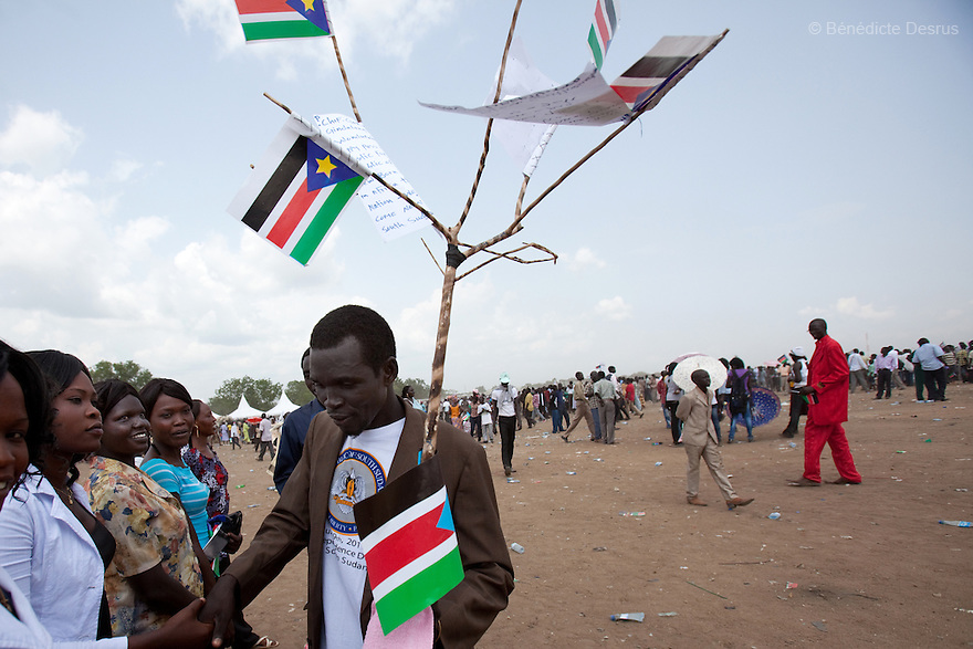 Saturday 9 july 2011 - Juba, Republic of South Sudan - A South Sudanese man holds flags of his new country during celebrations marking South Sudan's independence in Juba as it seceded from the north and became the world's newest nation. Tens of thousands of citizens of the new South Sudan celebrate national independence but whether statehood will resolve issues of identity after a decades-long war remains to be seen. Photo credit: Benedicte Desrus