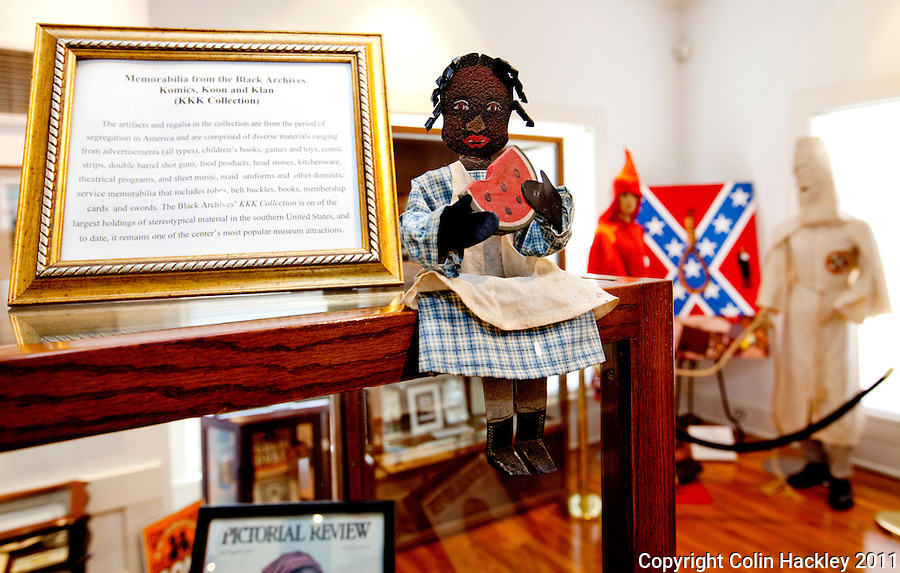 RACIAL STEREOTYPES THROUGH HISTORY: The Komics, Koon and Klan (KKK) Collection room in Tallahassee's Black Archives displays material produced during racial segregation. .COLIN HACKLEY PHOTO