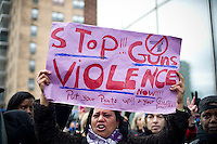 "Martina Garcia participates in the ""Too Many Victims"" march and rally in Harlem in New York on Sunday, January 8, 2012 on the one year anniversary of the Tucson shooting of  U.S. Representative Gabrielle Giffords and other victims. The event remembered all victims of gun violence with the lighting of candles. (© Frances M. Roberts)"