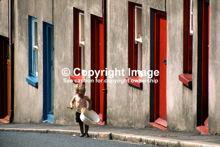 Child playing in the street in early autumn, Mount Street, Dromore, Co Down, N Ireland, September, 1971. 197109000454d..Copyright Image from Victor Patterson, 54 Dorchester Park, Belfast, United Kingdom, UK...For my Terms and Conditions of Use go to http://www.victorpatterson.com/Victor_Patterson/Terms_%26_Conditions.html