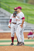 Florida State Seminoles third baseman Jose Brizuela (53) has a chat on the mound with relief pitcher Dylan Silva (24) during the game against the Wake Forest Demon Deacons at Wake Forest Baseball Park on April 19, 2014 in Winston-Salem, North Carolina.  The Seminoles defeated the Demon Deacons 4-3 in 13 innings.  (Brian Westerholt/Four Seam Images)