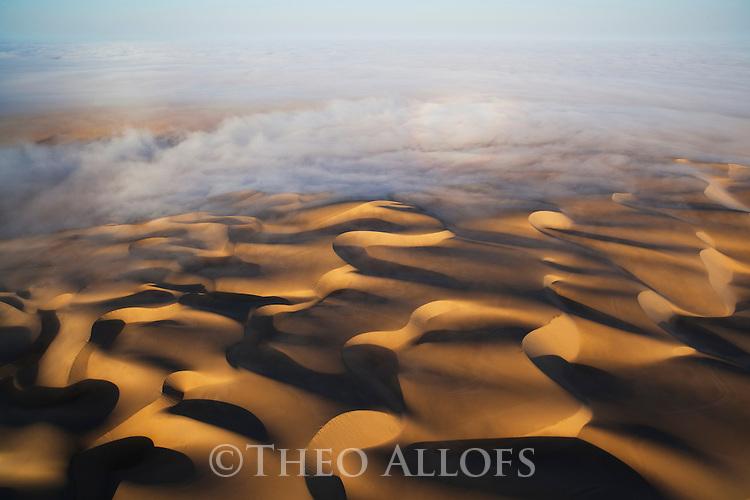 Namibia;  Namib Desert, Skeleton Coast, sand dunes south of Hoarusib River, Northern Skeleton Coast National Park, aerial view