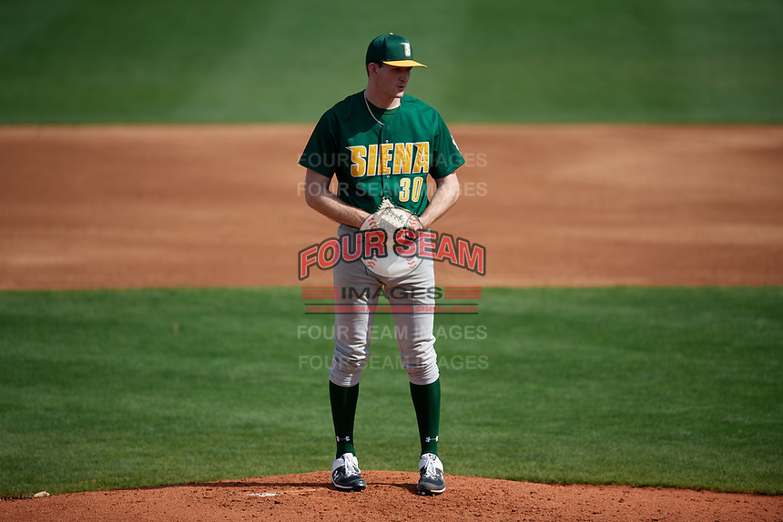 Siena Saints starting pitcher Dylan D'Anna (30) during a game against the UCF Knights on February 17, 2019 at John Euliano Park in Orlando, Florida.  UCF defeated Siena 7-1.  (Mike Janes/Four Seam Images)