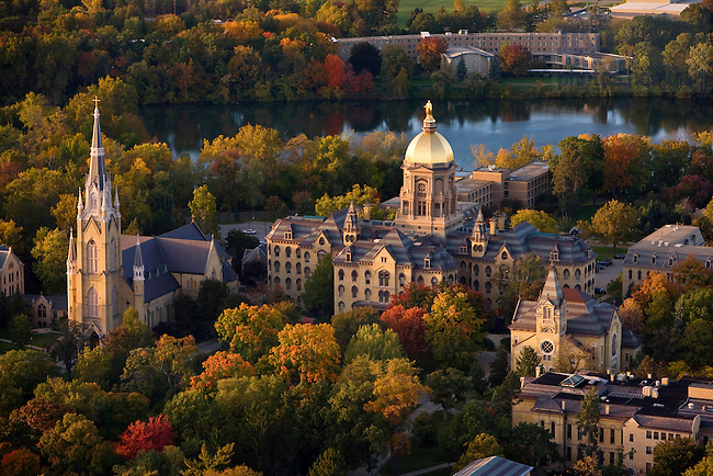"""Main Building and Basilica, also known as """"God Quad"""" in fall...Photo by Matt Cashore.."""